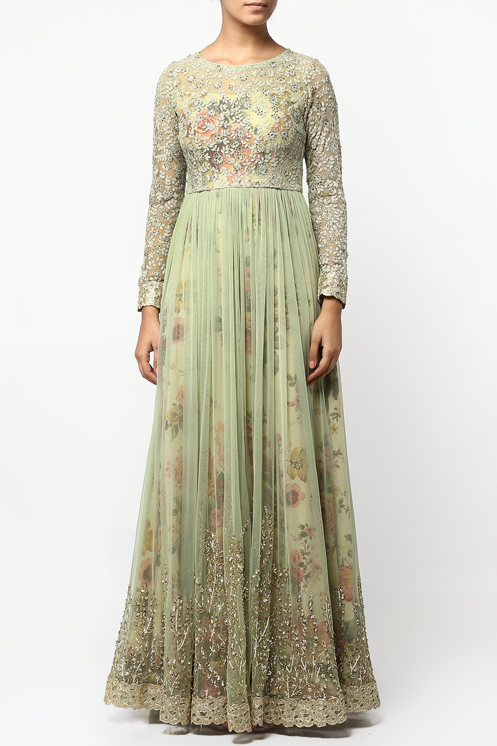 Featuring a mint green floral print floor length cotton anarkali dress with a matching net front slit overlay highlighted with sequin embroidered branches around the hem and appliqued lace border. It has a sequin and thread embroidered jaal net bodice and sleeves with applique lace around the cuffs.  Fabric: Cotton, Net  Care Instructions: Dryclean only.