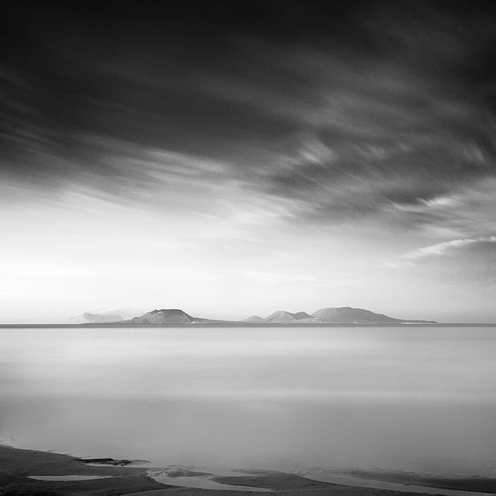 The island of Graciosa seen from Famara (Lanzarote). Canon EOS 5D MkII, EF 24-105mm, neutral density filter O.D. 3.0. 3 Minutes Long exposure, Raw, PS CS6. In Nature, Scenery, Waterscape. Dreaming An Island, photography by Bernd Walz. Image #447236
