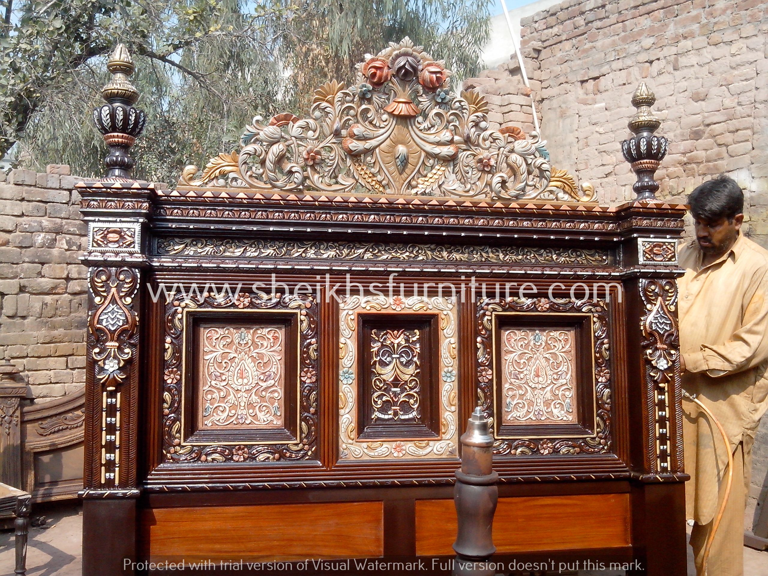 This is our solid rosewood bed. This bedroom set is made