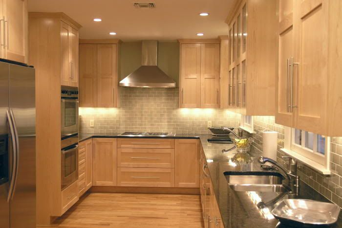 maple cabinets with subway tile backsplash and dark counters