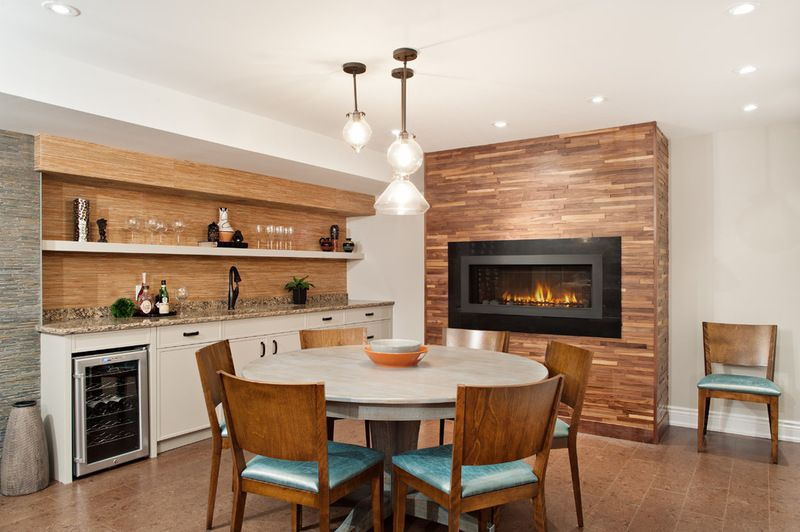 Linear Gas Fireplace Warms Up This Basement Wet Bar Area.