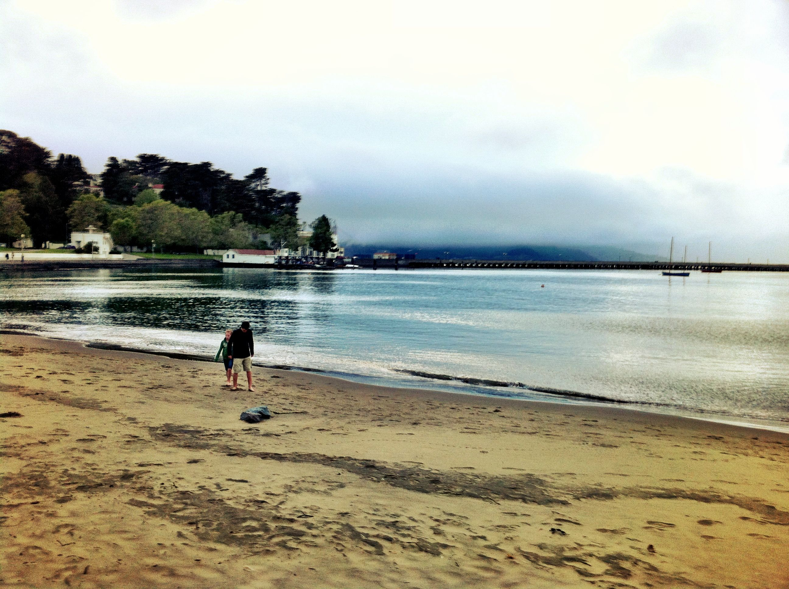 The beach in front of Ghirardelli Square. Walk west from here around that point in the distance to the Golden Gate Bridge or east through Fisherman's Wharf, along the Embarcadero to the Ferry Building. Photo by sarah peck