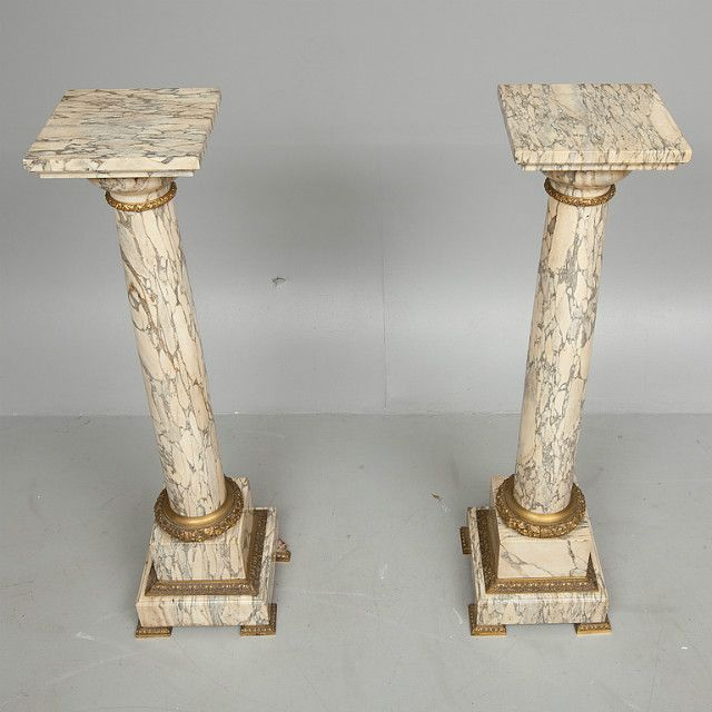 A pair of marble pedestals