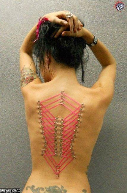 pierced tattooed studs making out