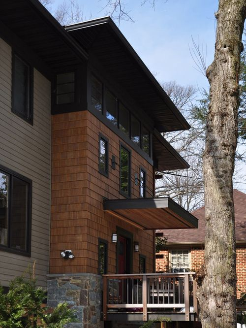 This project in Chevy Chase, Maryland was restricted by zoning to the small footprint of the existing structure.  The Owners needed more space for their growing family, and had as their central goal