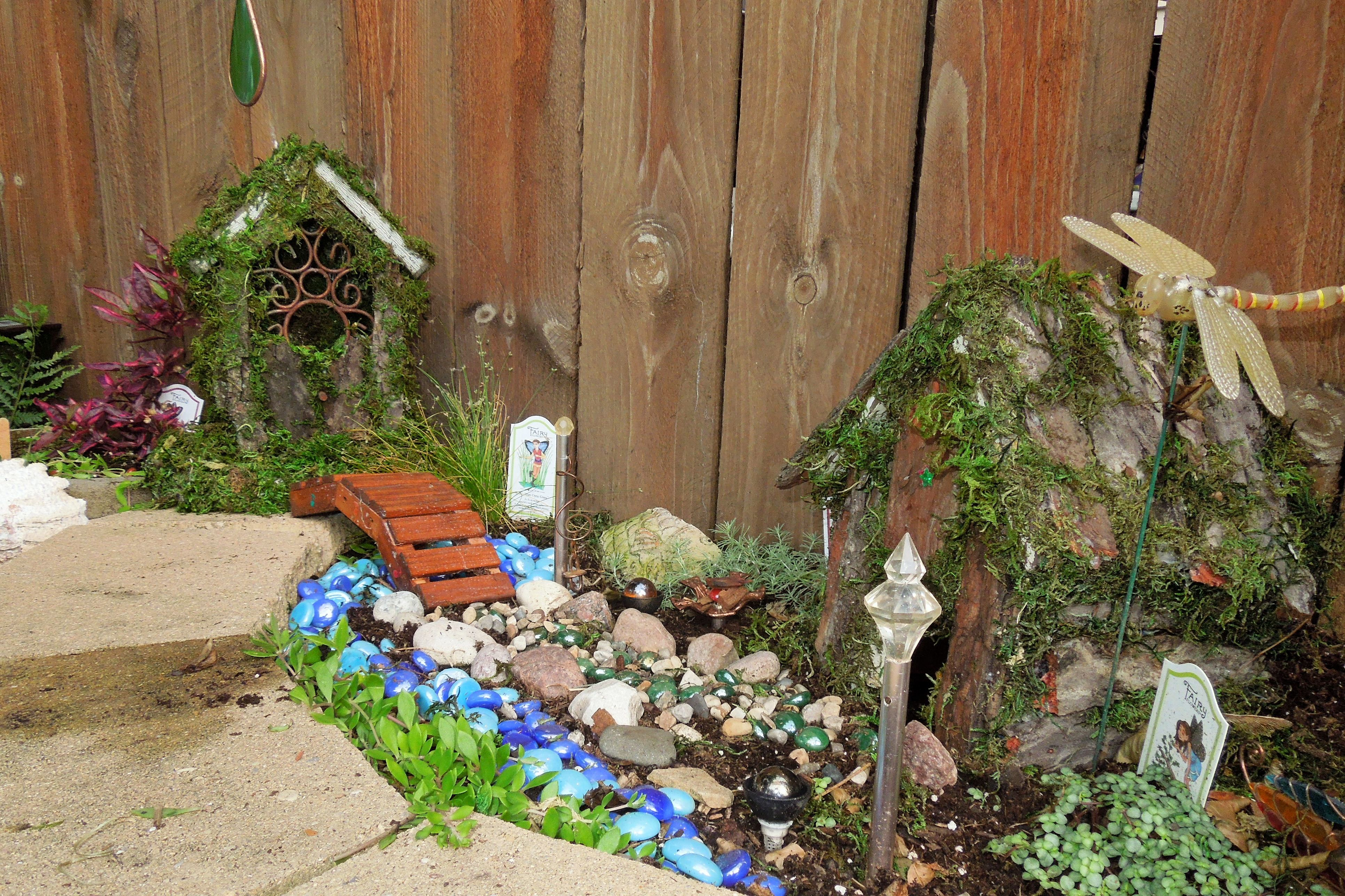 The two birdhouses are covered with tree bark and dried moss. My ...