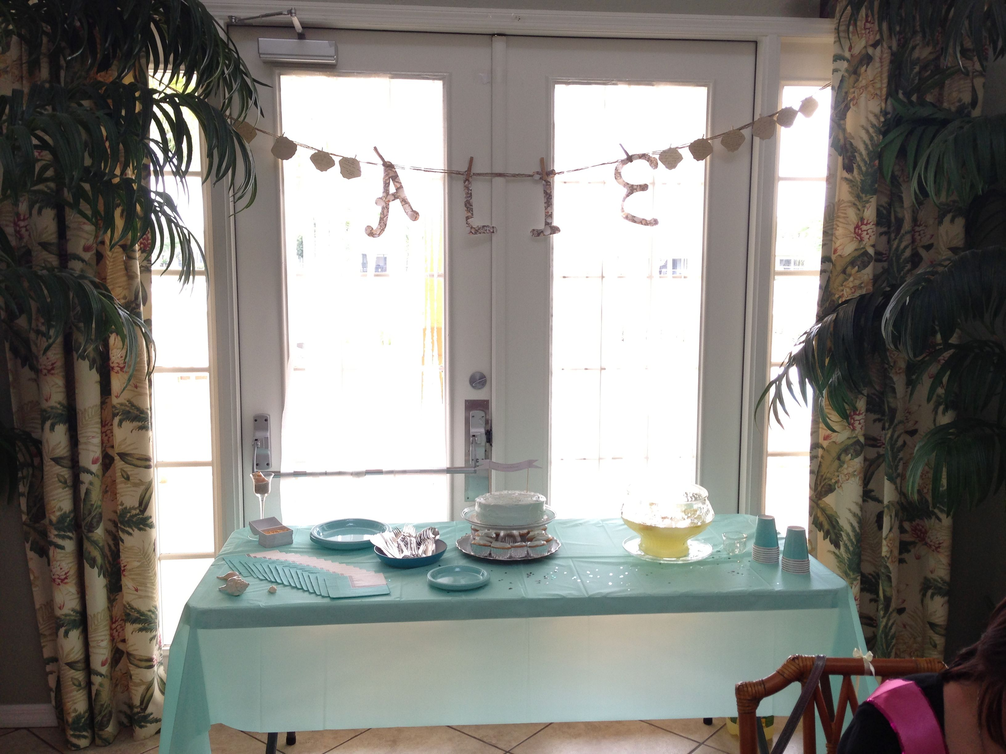 cake & lemonade at table - beach theme bridal shower .. shell paper name banner w/shell cut out wishes from guests