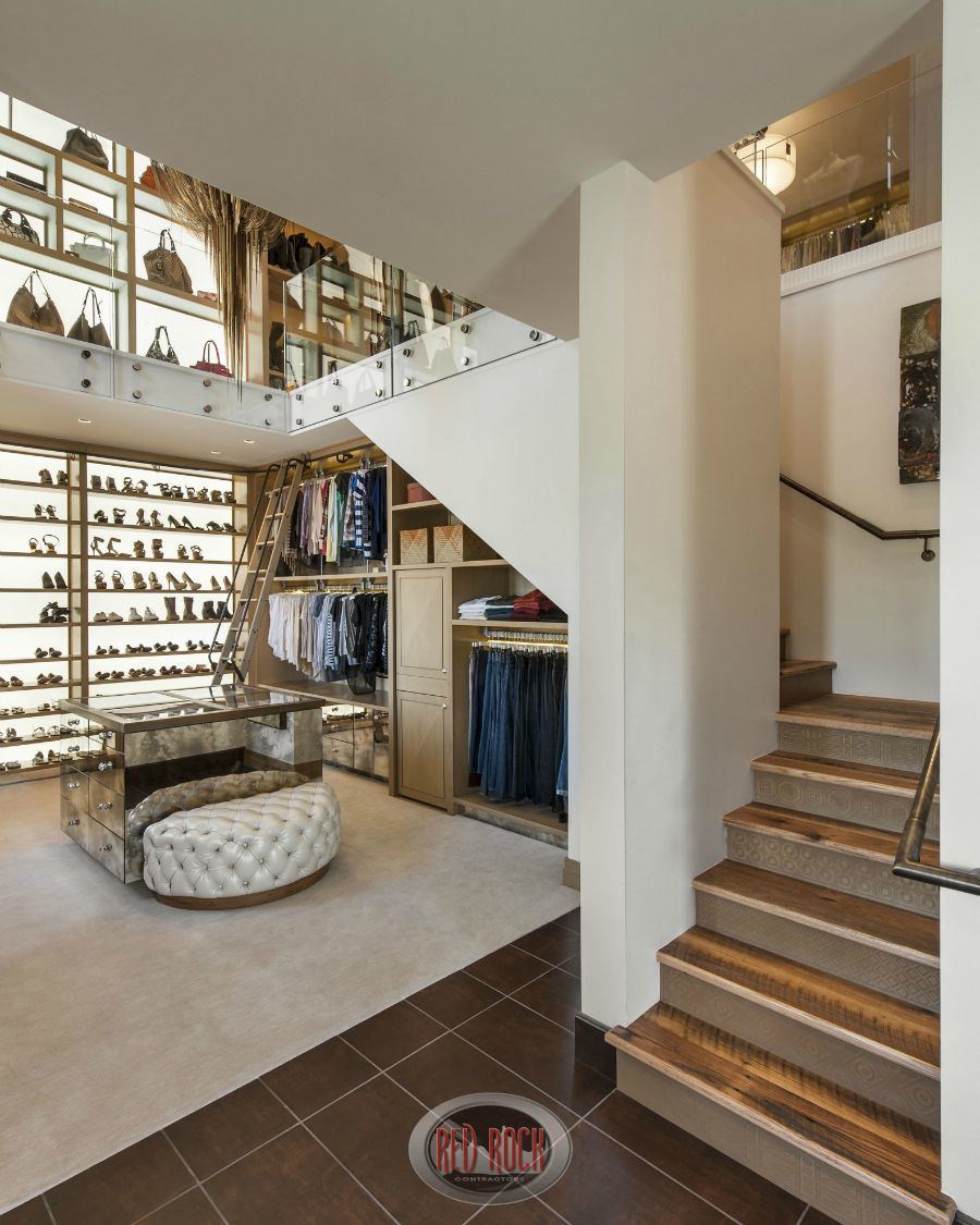Here's spectacular walk-in closet number 2 done in a very different design motif.  Spanning two levels, this changing room and walk-in closet offers plenty of space and storage including floor-to-ceiling custom shoe storage.
