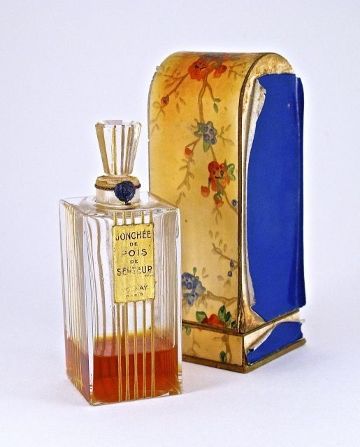1928 Volnay Jonchee de Pois de Senteur perfume bottle and stopper, clear glass, gilt recessed lines, label, box (worn). 4 in.