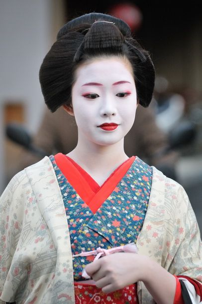 This appears to be a maiko, but I've left the original tag on it with the info   Geisha on the Streets of Gion, Geiko Ichiyuri of Gion Kobu.