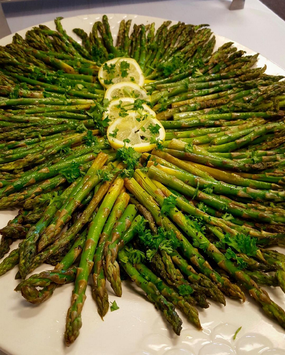 Roasted asparagus with truffle oil and lemon drizzle.