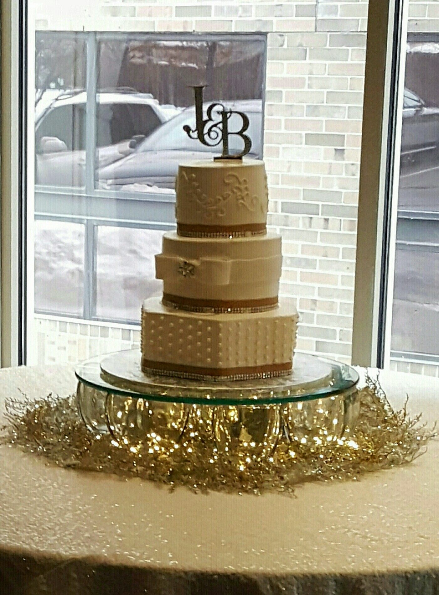Diy Wedding Cake Stand Sitting Atop Mat Created With 20 Round Thick Gl Silver Gold Christmas Fls From H L Vases W Mart