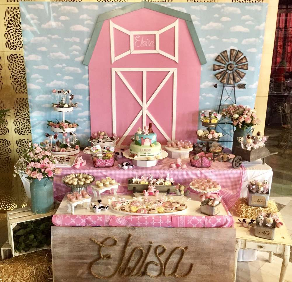 The pink dessert table at this Farm Baby Shower is so