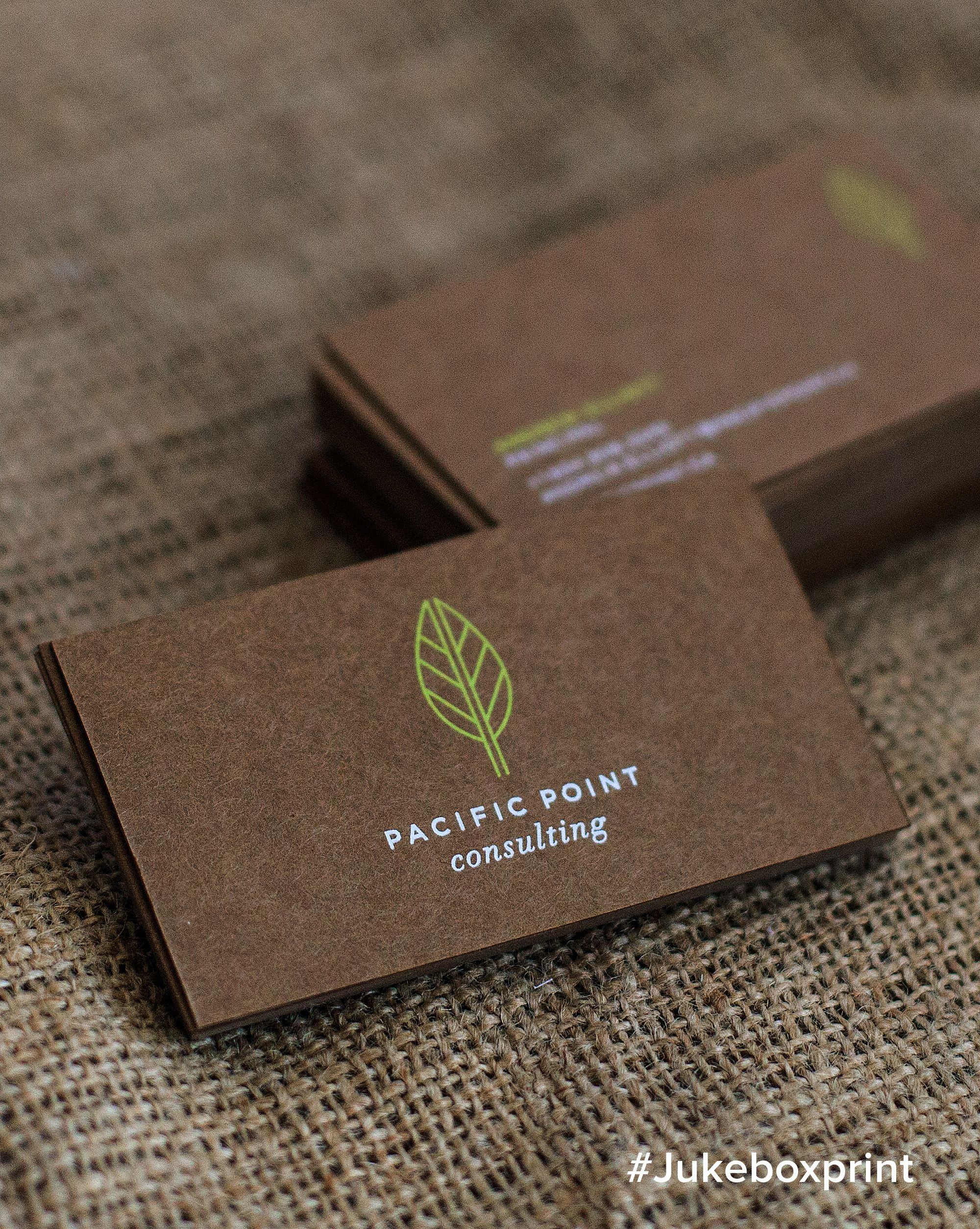 elegantly produced brown kraft business cards with white neon green silkscreen printing designed by cosette produced by jukebox print - Kraft Business Cards