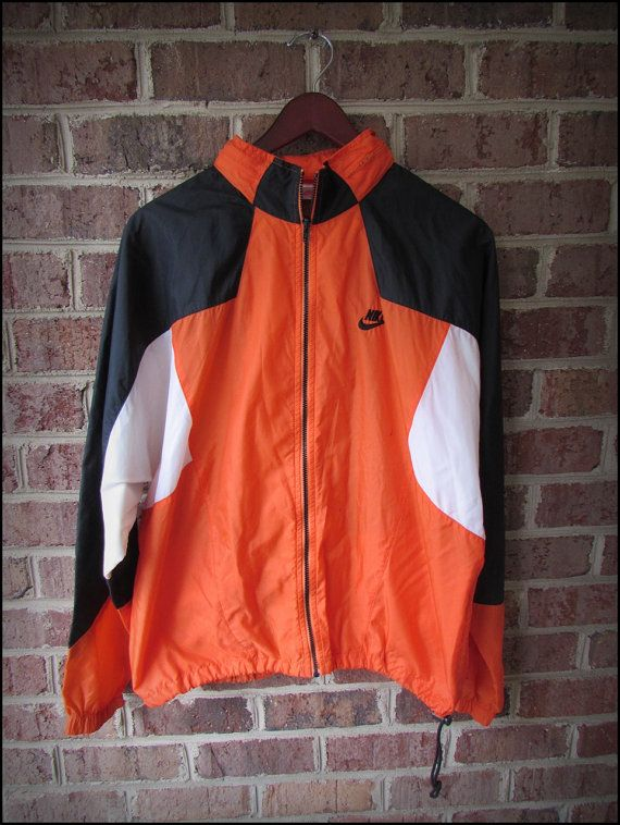 0ef8488c28fbd Vintage 90 s Nike Orange Black Running Track Jacket by CharchaicVintage
