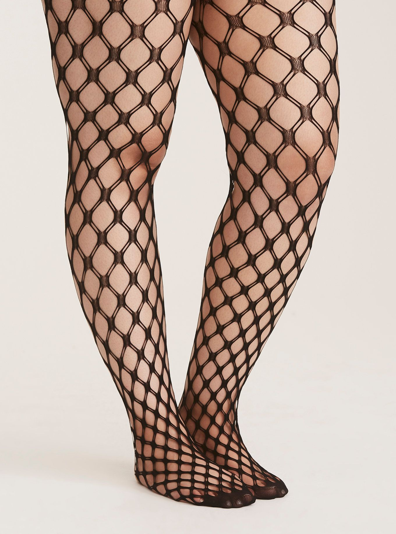 985302f7e70c4 We've put a bold twist on the classic fishnet tights. The thick double  weave on these tights will make anything you wear them with 100x more sexy.  Size ...