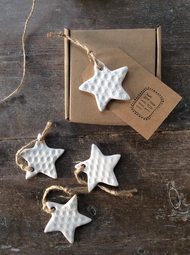 Handmade Ceramic White Star Ornament With Daisy Design Etsy Clay Christmas Decorations Handmade Christmas Gifts Ceramic Christmas Decorations
