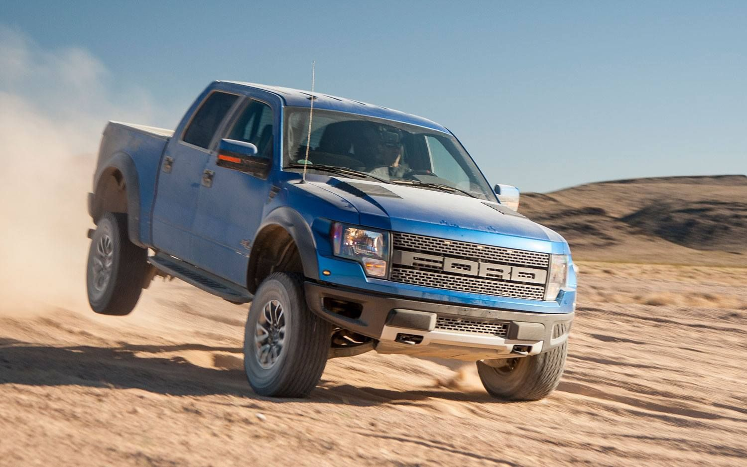 Blue ford raptor svt truck out having fun offroad