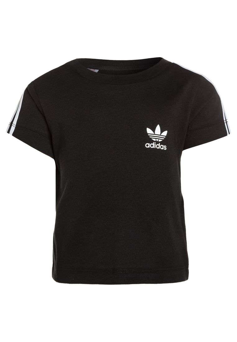 6dacb522ff ¡Consigue este tipo de camiseta estampada de Adidas Originals ahora! Haz  clic para ver