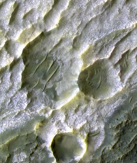Surface of the Red Planet: images from NASA's Mars Reconnaissance Orbiter satellite The colours in this image resemble natural appearance, but are not true colour. The chloride mineral deposits look like salt pans on Earth. The evidence of salt remnants is important because they pinpoint regions where water once flowed AP / NASA