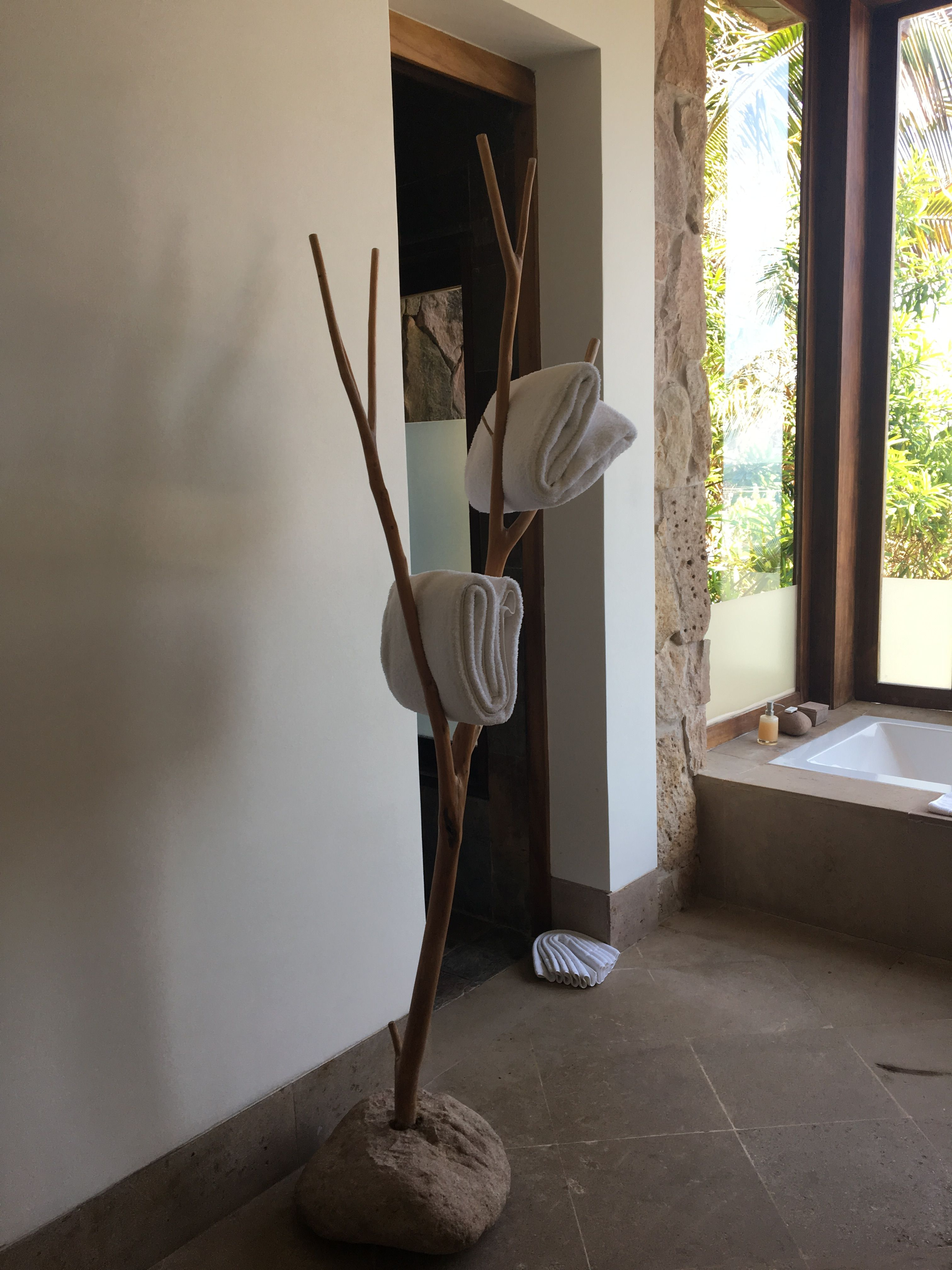 Very ucgreenud way to rack towels and dry clothes anchored by a stone