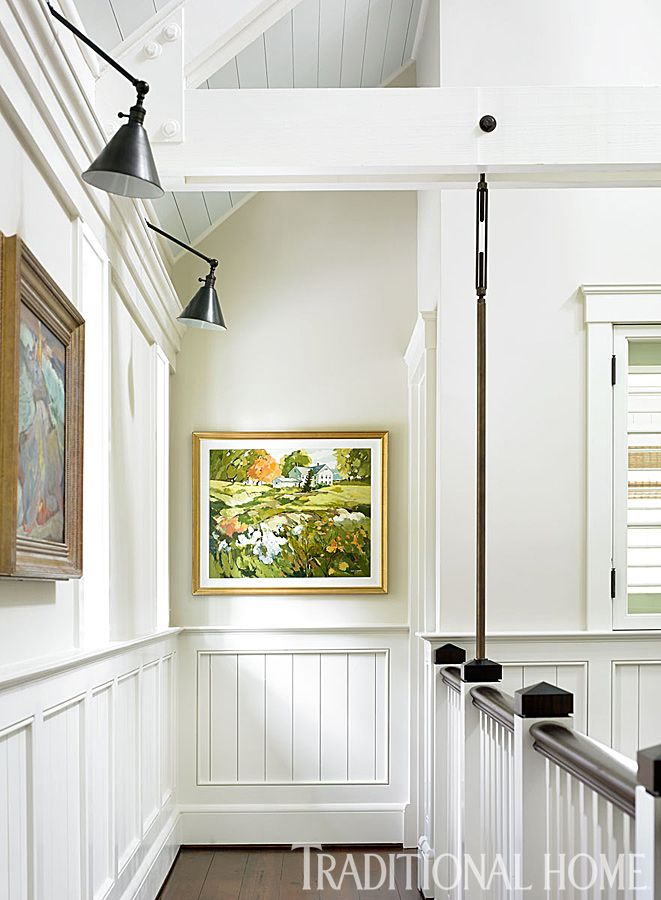 Art lines the walls of the catwalk-like gallery overlooking the great room. - Photo: Emily Jenkins Followill / Design: Wendy Kirkland