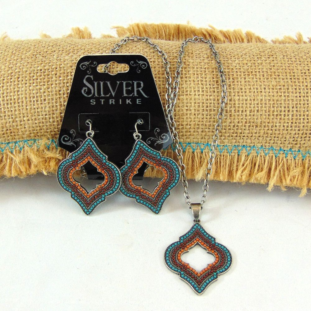 Orange, Brown and Turquoise medallion necklace and matching earrings by Silver…