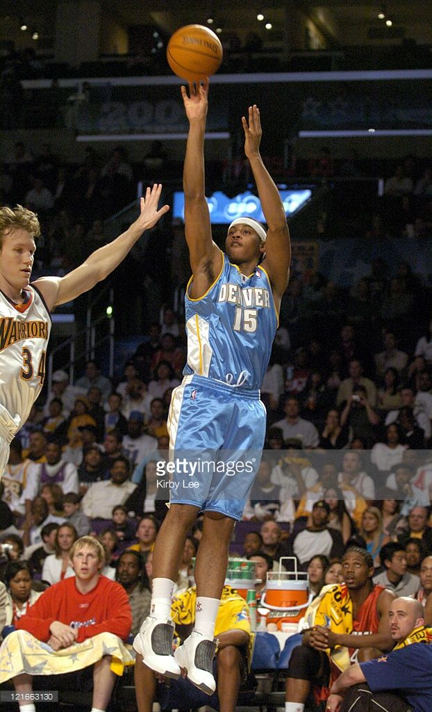 Nba all star rookie challenge february 13 2004 nba and denver denver nuggets rookie carmelo anthony takes a jump shot during the nba all star rookie voltagebd Choice Image