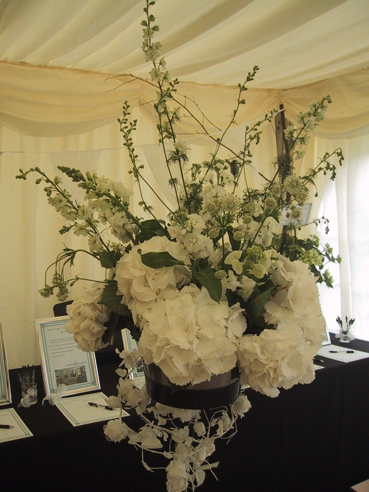 Pedestal arrangement using white hydrangeas nicolamay