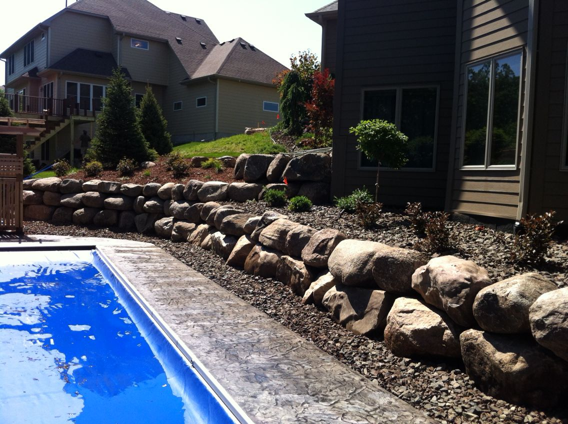 Stamped Concrete Pool And Terraced Boulder Retaining Walls Concrete Pool Concrete Decor Boulder Retaining Wall