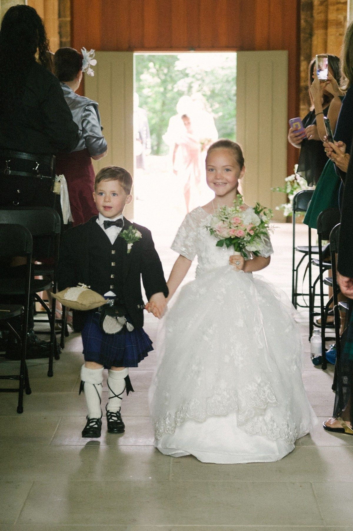 7373e5ef350 Flower girl and page boy from an American-English and travel inspired  wedding in Scotland. Images captued by ChicPhoto.