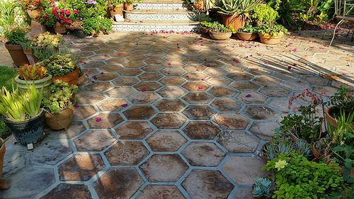 Large Hexagon Tile   Tile Shapes  Hexagons   Pinterest   Cement     Large hexagon tile adorn this patio  The rustic look is created with cement  tiles and a vintage texture