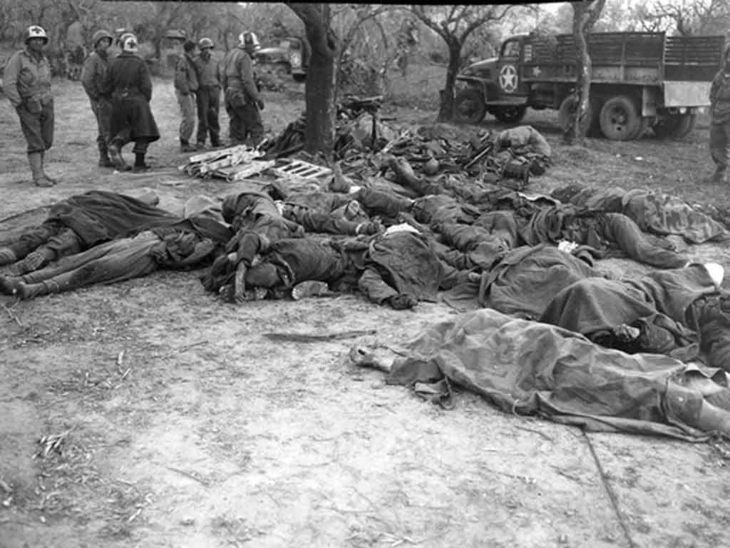 Dead German soldiers and their equipment at a collection ...