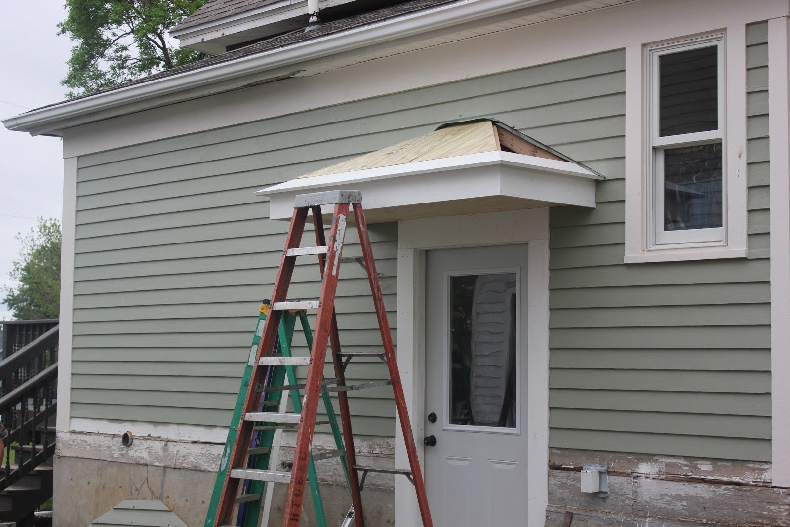 Got The Frame Up And Bolted To The House Thanks Again Mark Marlene For Taking Time Out Of Your Weekend To Help U Door Overhang Door Awnings Awning Over Door