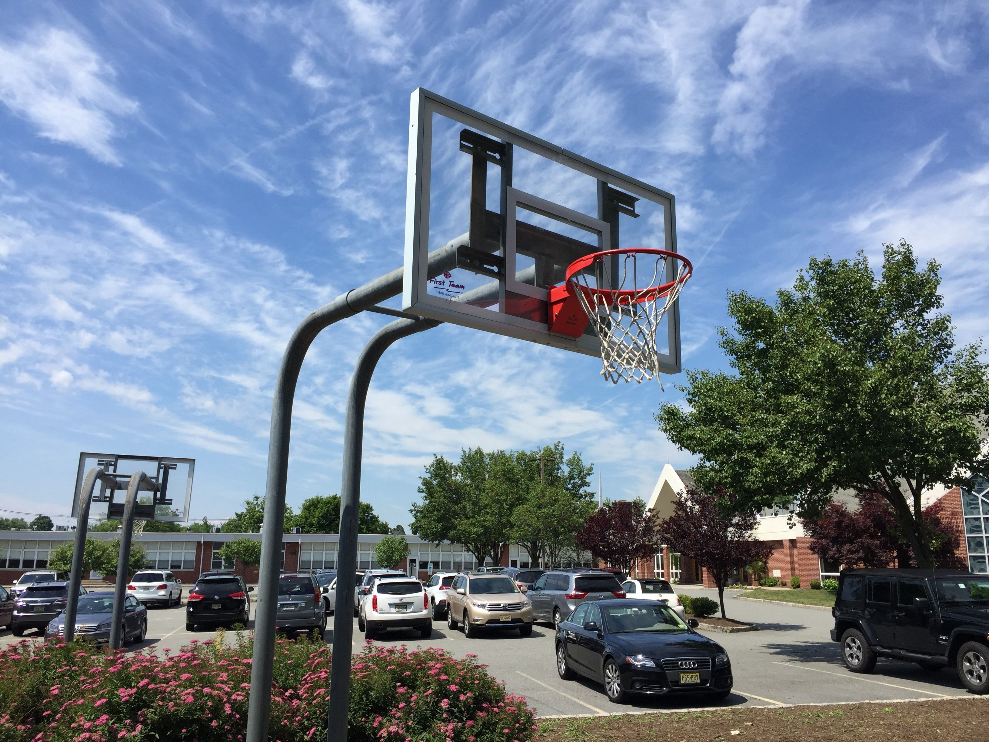 first team attack select adjustable basketball hoop in the driveway