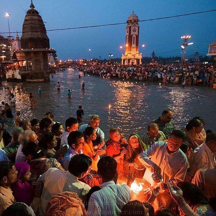 """""""Photograph by @JohnStanmeyer  Thousands of Indian Hindus come out to witness the Ganga Aarti (river worshiping ceremony) at the Har-Ki-Pairi Ghat located…"""""""