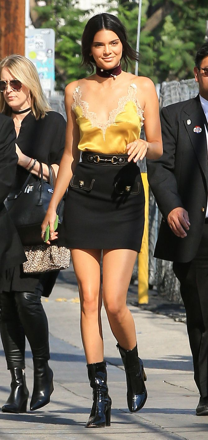 fc78ee39a6 Kendall Jenner in a yellow lace Gucci top, black miniskirt, choker and boots