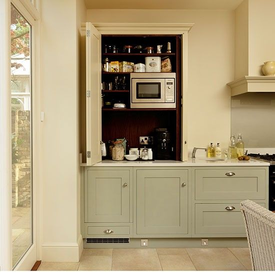 Traditional stule cream and green kitchen with concealed for Traditional kitchen appliances