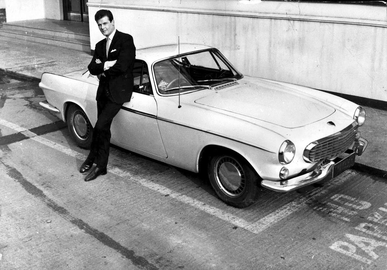 A Young Roger Moore With His Volvo P1800 From The Saint