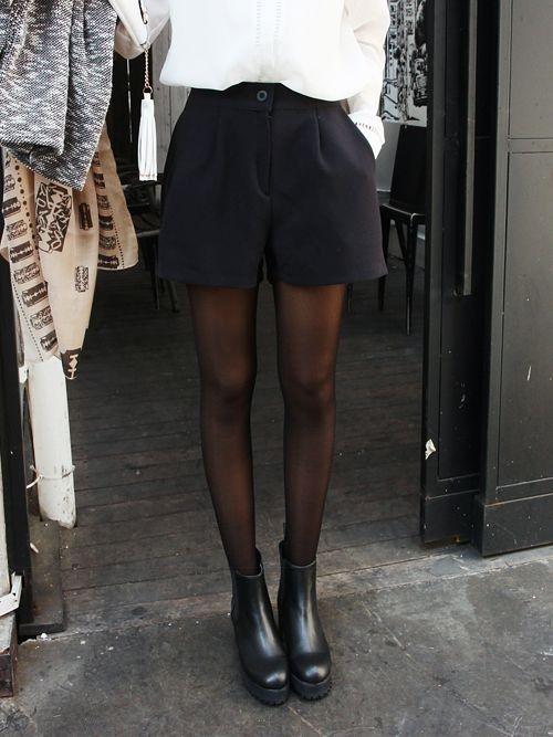 White shirt + black shorts + sheer collants + black boots