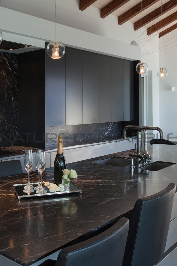 All black kitchens are becoming the trend and this  is one to be inspired by.  #stone #undermountsink #floridainteriors #floridaproperty #floridahomes #floridaarchitecture #interiordesign #interior123 #interiordesigner #interiordecorating #kitchensofinstagram #black #allblack #blackonblack #blackkitchen #porcelain