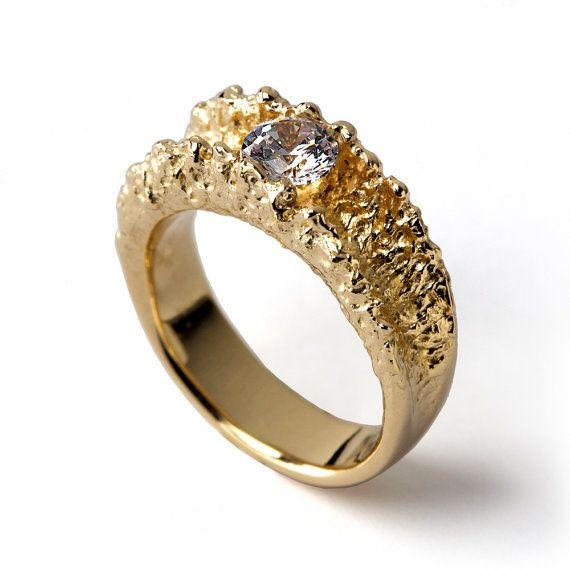 SURF is an original gold ring, whose design was inspired by the high waves in the beach where I love to spend my summers. I played with the idea of