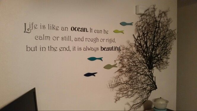 My dining room wall. Coral pieces given to me by a friend. Fish are wood cut by my dear hubby.