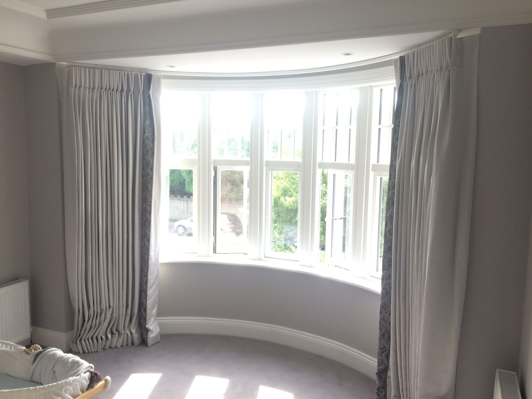 curved bedroom curtain bay window with zoffany trim