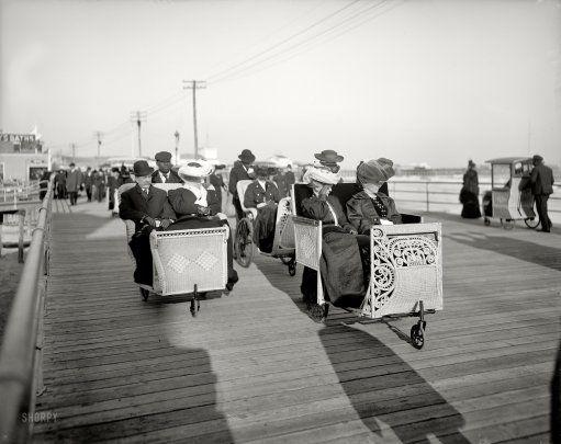 atlantic city boardwalk nj rolling chairs wearing hats and long