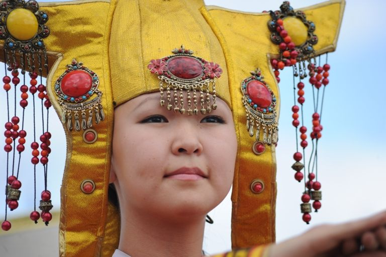 Tuvan girl in traditonal dress and ornaments.
