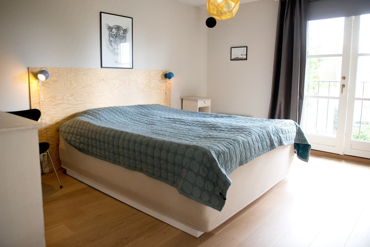 A Clean Colorful Oslo Townhome Black Upholstered Headboard Apartment Therapy House Tours Country Headboard