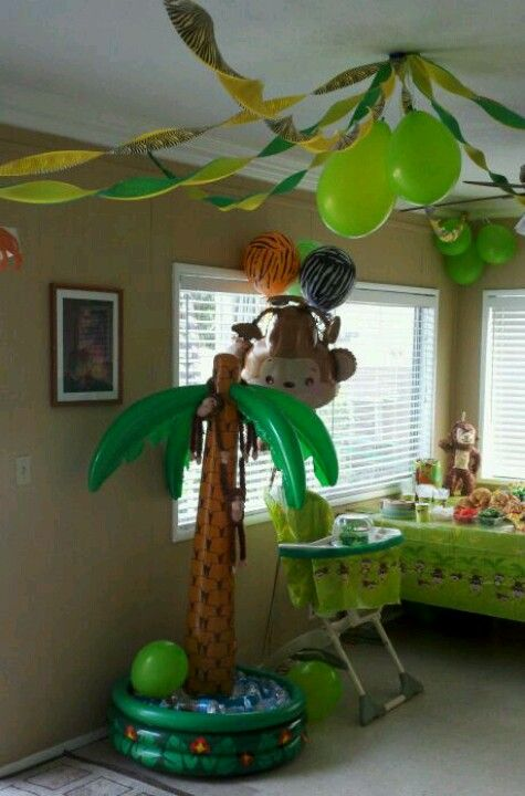 My son 39 s first birthday party safari style inflatable for Monkey decorations
