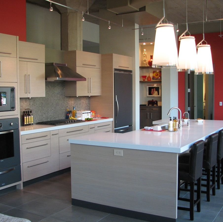 Urban kitchen design with glossy white countertop and grey ...