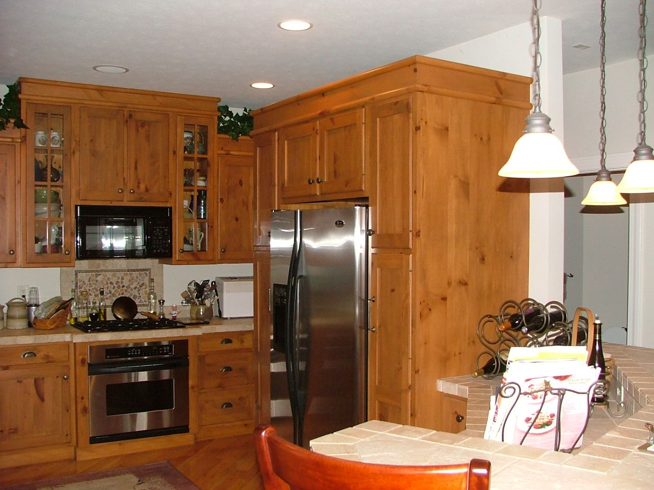 Knotty Pine kitchen with tile tops   Lake house kitchen ...